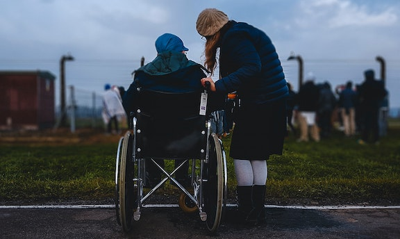 two women, one is in a wheelchair